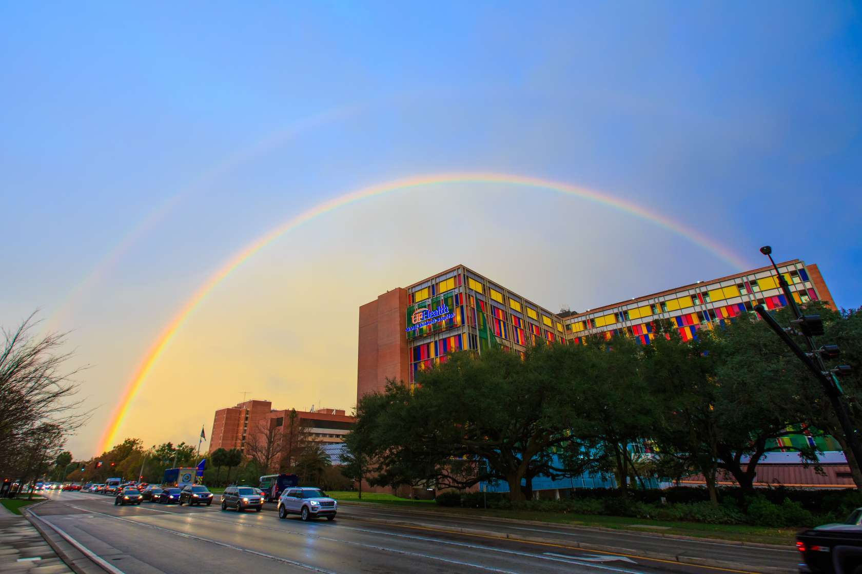 Exterior of UF & Shands Children's Hospital with rainbow over the building